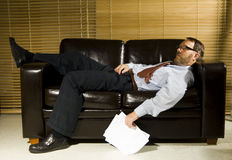 Tired businessman. Sleeping on a couch Stock Photos