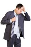 Tired businessman. Young businessman, tired of working too much, isolated on white Stock Photo