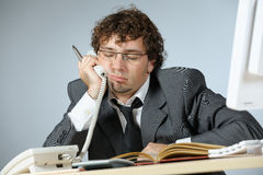 Tired businessman. Horizontal image of tired young businessman Stock Image