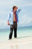 Tired businessman on the beach Stock Photo