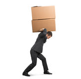 Tired businessman carrying boxes Royalty Free Stock Images