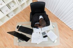 Tired Businessman At Desk Royalty Free Stock Image