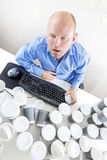 Tired businessman drinks too much coffee at office Royalty Free Stock Photography