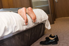Tired businessman drunk in hotel. Stock Photos
