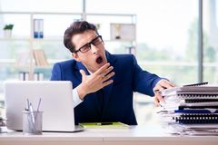 Tired businessman exhausted after hard work and excessive worklo Royalty Free Stock Photo