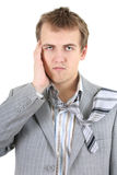 Tired businessman in grey suit Stock Image