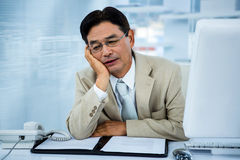 Tired businessman holding his head Royalty Free Stock Photography