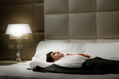 Tired Businessman Lying On Bed Royalty Free Stock Images