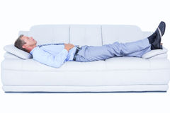 Tired businessman lying on the sofa Royalty Free Stock Photography