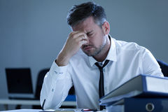 Tired businessman in the office Royalty Free Stock Images