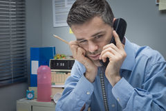 Tired businessman on the phone Stock Photography