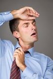 Tired businessman. Pulling out his collar Royalty Free Stock Image
