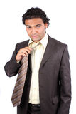 Tired Businessman Removing Tie Stock Photo