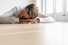 Tired businessman resting at his office desk royalty free stock images