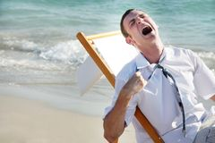 Tired businessman on sea Stock Photo