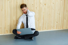 Tired Businessman Sitting on Floor at His Office. Hard Work and Royalty Free Stock Image