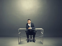 Tired businessman sitting Stock Photos
