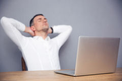 Tired businessman sitting at the table in office Royalty Free Stock Photography