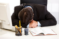 Tired businessman sleeping at  desk in  office Stock Photos