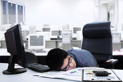 Tired businessman sleeping on the desk Stock Photo