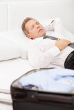 Tired businessman sleeping. Stock Photography