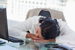Tired businessman sleeping on his desk Royalty Free Stock Photo