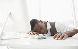 Tired businessman sleeping on keyboard Stock Images