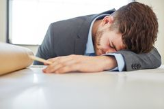 Tired businessman sleeping Royalty Free Stock Photos