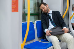 Tired businessman sleeping on the underground Royalty Free Stock Photos