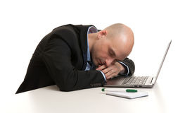 Tired businessman sleeping at work place Royalty Free Stock Image