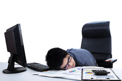 Tired businessman sleeping at workplace Stock Photos