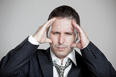 Tired Businessman with stress headache Stock Image