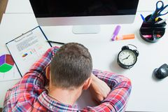Tired businessman student sleeping on working office desk Stock Photo