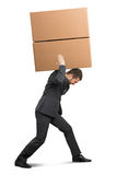 Tired businessman in the suit carrying Stock Photo