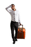 Tired businessman with suitcase Stock Photo