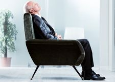 Tired businessman taking a moment to relax stock photography