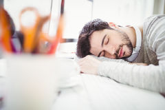 Tired businessman taking nap in office Royalty Free Stock Photo