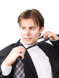 Tired businessman taking off his tie Stock Photos