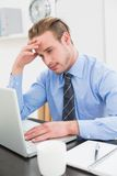 Tired businessman using his laptop Royalty Free Stock Images