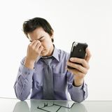 Tired Businessman With Cell Phone. Royalty Free Stock Photo