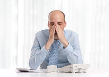 Tired businessman at work Royalty Free Stock Photo