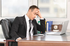 Tired businessman at work royalty free stock image