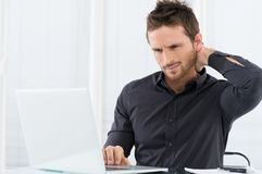 Tired Businessman. Businessman Tired Working On Laptop Stock Photography