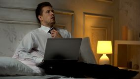 Tired businessman working at night instead of sleeping, busy lifestyle, deadline royalty free stock photography
