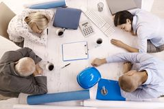 Tired businesspeople at meeting Stock Photos