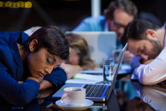 Tired businesspeople sleeping in office. At night Royalty Free Stock Photo