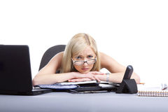 Tired businesswoman. Businesswoman sitting at the table stressed and tired at work stock photography