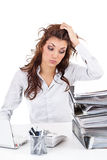 Tired businesswoman. With paperwork isolated on white royalty free stock photo