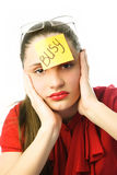 Tired businesswoman. Portrait of a tired unhappy businesswoman with a note busy on her forehead Royalty Free Stock Image