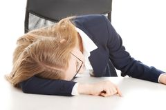 Tired businesswoman. Beautiful young blonde tired businesswoman Royalty Free Stock Images